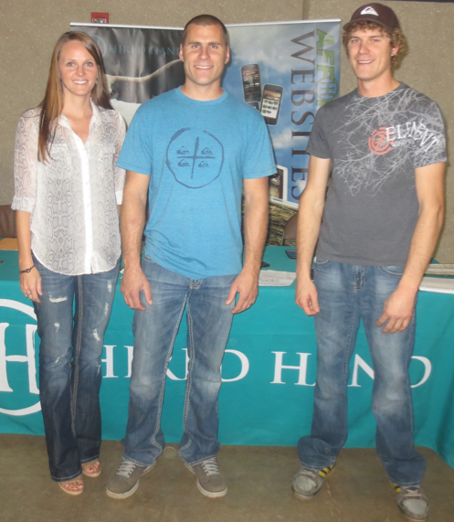 Hired Hand's Jaymie Feldmann with Meridian Longhorns owner Jeff & John Jesperson