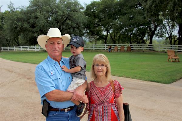 Hired Hand customers Mr & Mrs Stojanik, Lone Star Longhorns with grandson Connor.