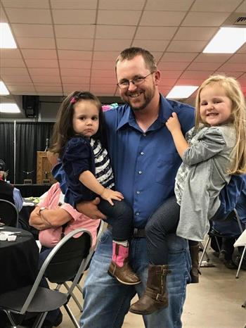 Justin Rombeck with his daughters